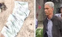 Ông Đặng Trường An cùng 2.500 USD tang vật. Ảnh: Tân Châu
