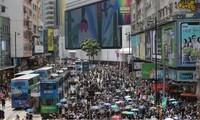 Người Hong Kong xuống đường biểu tình cuối tuần qua để phản đối luật an ninh quốc gia mới. (Ảnh: SCMP)