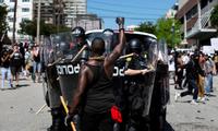 Biểu tình đang lan rộng ở nhiều thành phố của Mỹ để phản đối tình trạng đối xử bất công với người da màu. (Ảnh: Reuters)