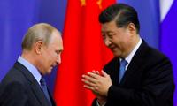 Tổng thống Nga Vladimir Putin và Chủ tịch Trung Quốc Tập Cận Bình trong một dịp gặp. (Ảnh: AP)