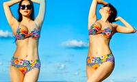 Mẹ 2 con Khánh Thi diện bikini khoe dáng 'cực phẩm' gây ngưỡng mộ