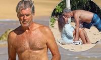 'Điệp viên' Pierce Brosnan phong độ U70, hôn vợ nồng nàn trên biển Hawaii