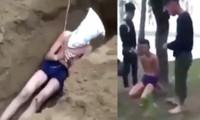 Hình ảnh nam thanh niên bị nhóm người tra tấn, hành hung