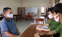Nguyễn Quốc Toàn tại thời điểm bị công an bắt theo lệnh truy nã.