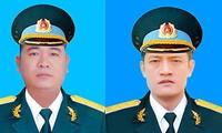 Hai phi công Khuất Mạnh Trí (ảnh phải) và Phạm Giang Nam được truy thăng quân hàm.