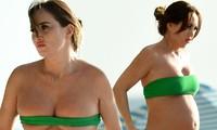 Mang bầu, Lauryn Goodman táo bạo diện áo tắm như không mặc trên biển