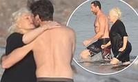 'Người sói' Hugh Jackman cơ bắp rắn rỏi tuổi 52, ôm hôn bà xã U70 ở biển