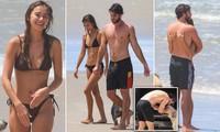 Liam Hemsworth tình tứ bạn gái người mẫu ở biển