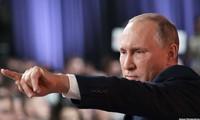 Tổng thống Nga Vladimir Putin tại cuộc họp báo cuối năm ngày 14/12. Ảnh: TASS