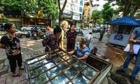 Thau dọn bể tại 1 số chung cư sử dụng nguồn nước sông Đà. Ảnh: Trần Hoàng