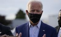Ứng viên đảng Dân chủ Joe Biden phát biểu với báo giới trước khi lên máy bay ở Delaware ngày 23/9. Ảnh: AP