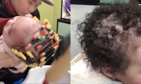 Phẫn nộ clip bé 1 tuổi bị bà đè ngửa, đổ hoá chất làm tóc xoăn ở tiệm làm đầu