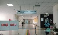 Hai nhân viên y tế mắc Covid-19 đang được điều trị tại Bệnh viện Nhiệt đới Trung ương Nguồn: NLĐ
