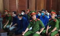 Các bị cáo tại phiên tòa. Ảnh: Tân Châu
