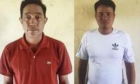 Hai bị can Dũng và Uần tại cơ quan điều tra trong vụ tống tiền CSGT tỉnh Tiền Giang.