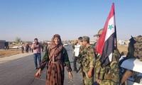 Một hình ảnh do hãng tin Syria Sana đăng tải với chú thích người dân ở miền Đông bắc hoan nghênh quân chính phủ tiến vào để đương đầu với lực lượng của Thổ Nhĩ Kỳ