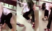 Nữ sinh lớp 10 bị đánh hội đồng, xé áo dài tại trường