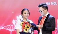 Em Hoàng Thị Yến, học sinh trường THCS Tôn Thất Tùng tại Lễ tuyên dương Cháu ngoan Bác Hồ toàn quốc lần thứ IX Ảnh: Như Ý