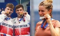 Đố bạn đoán được: Lý do VĐV Olympic hay đưa huy chương lên miệng để cắn khi chụp ảnh?