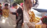 Cô dâu ở Trung Quốc đeo 30kg vàng nhà chồng tặng trong ngày cưới khiến netizen tranh cãi