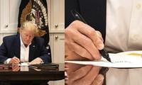 """Tổng thống Trump bị trêu """"sống ảo"""" vì ảnh làm việc trong viện, hóa ra chỉ ký giấy trắng"""
