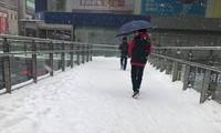 Tuyết phủ kín sân Thường Châu ngay trước chung kết U23