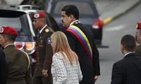 Tổng thống Nicolas Maduro và phu nhân. Ảnh: AFP