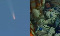 Tàu vũ trụ Soyuz (trái) và 2 phi hành gia Nga - Mỹ (phải). Ảnh chụp màn hình