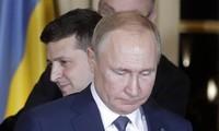 Tổng thống Nga Putin và Tổng thống Ukraine Zelensky. Ảnh: Tass