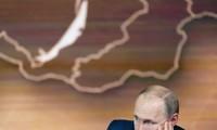 Ông Putin trong cuộc họp báo chiều 19/12. Ảnh: Sputnik
