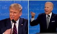Hai ông Trump - Biden trong buổi tranh luận đầu tiên. Ảnh: Reuters