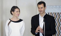 Ông Assad và phu nhân. Ảnh: SANA