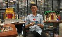 Hoang Dang và kho Lego tại nhà ở Hà Nội. Ảnh: Reuters