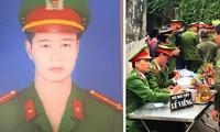 Gia đình tổ chức đám tang cho thượng uý Nguyễn Tuấn Minh - Ảnh: Hoàng Long