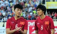 HLV Hữu Thắng đang rất chờ đợi sự trở lại của Xuân Trường (trái).