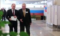 Tổng thống Nga Putin đi bỏ phiếu tại Moskva. Ảnh: Sputnik