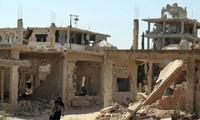 Thành phố Deraa, Syria, không xung đột vào ngày 9/7 sau lệnh ngừng bắn. Ảnh: Reuters