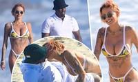 Mỹ nhân Tina Louise hôn đắm đuối 'trùm' hip-hop trên bãi biển