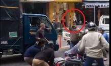 Cảnh sát nổ súng giữa phố khống chế 2 nghi phạm