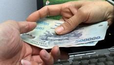 Bắt quả tang một cán bộ phường ở TPHCM nhận hối lộ