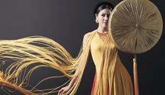 Nguyễn Thị Loan mang áo tứ thân tới Hoa hậu Hòa bình quốc tế