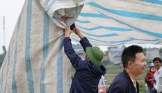 Hình ảnh người dân Nam Sơn tháo lều bạt sau đối thoại với chính quyền