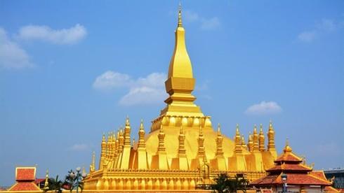 Công trình biểu tượng văn hóa Phật giáo nào được coi là biểu tượng nước Lào, xuất hiện trên quốc huy và tiền của nước này?