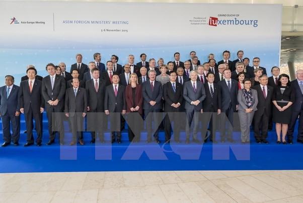 Trưởng đoàn chụp ảnh chung tại Hội nghị Bộ trưởng Ngoại giao lần thứ 12 của Diễn đàn hợp tác Á-Âu (ASEM) . (Ảnh: TTXVN)