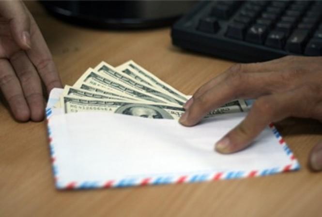 Bắt phó viện trưởng Viện KSND đang nhận hối lộ 2500 đô la