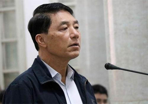 Cựu thứ trưởng công an Trần Việt Tân trong 1 lần hầu tòa. Ảnh: TTXVN