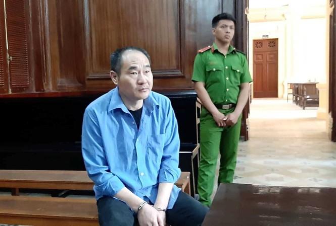 Ren Dan Jun - công dân Trung Quốc bị tòa án ở TPHCM xét xử vì trộm cắp tiền trên máy bay.