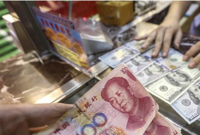 Động thái hạ giá đồng nhân dân tệ của Trung Quốc được cho là nhằm trả đũa việc Mỹ sắp tăng thuế tiếp lên hàng nhập khẩu từ Trung Quốc. (Ảnh: SCMP)