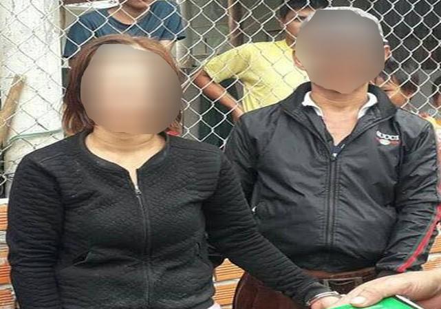 Cặp vợ chồng đi hốt thuốc Đông y bị vây bắt vì nghi bắt cóc trẻ em. Ảnh: Ảnh chụp màn hình