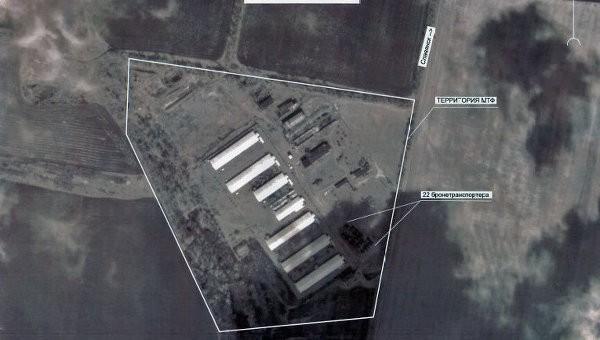 Hình ành thu được từ vệ tinh cho thấy một lượng lớn binh sĩ và khí tài quân sự Ukraine tập trung gần thành phố Slaviansk. Ảnh: RIA Novosti